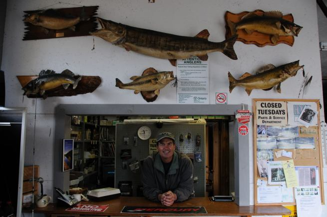 Dave Smith poses with his family tree of fish