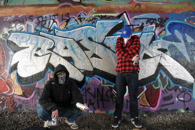 Graffitti Artist under overpass, Ottawa, Ontario.