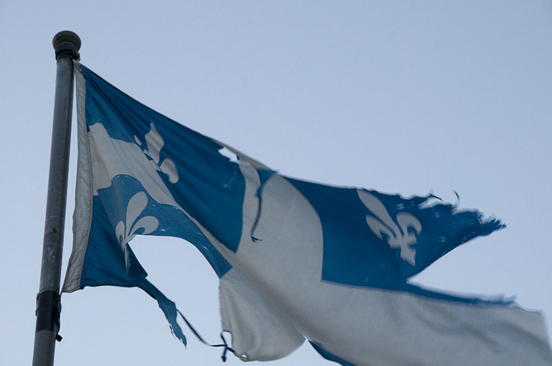 Pictures Of Quebec Flag. quebec-flag-torn