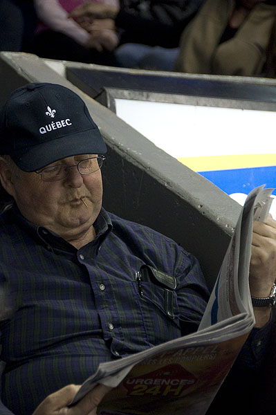 reading-the-paper-with-quebec-hat