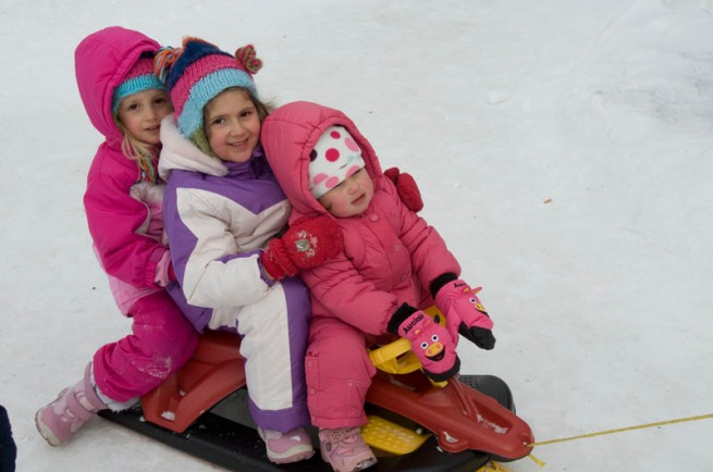 three-little-kids-on-sled