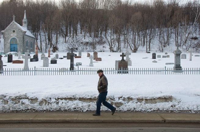 walking-by-cemetery-in-st-anne-de-beaupre