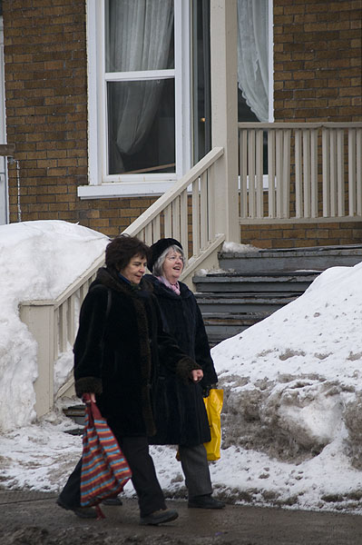 women-chatting-on-street