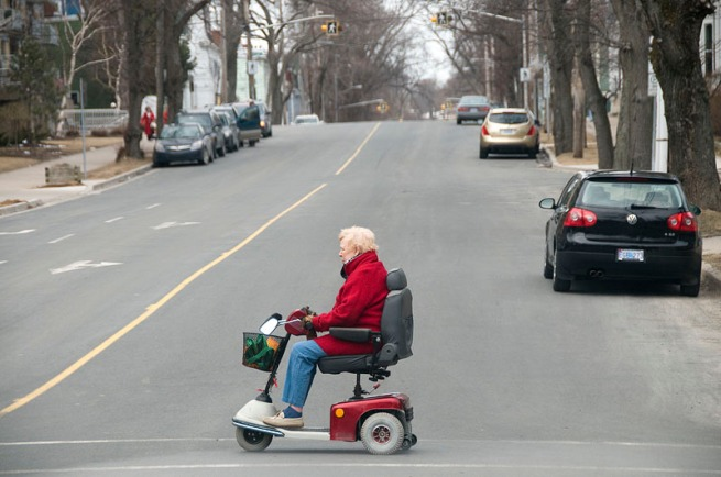 crossing-the-road-in-wheel-chair