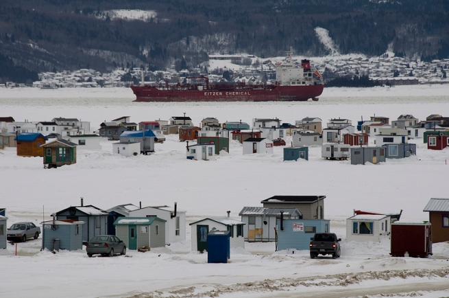 Ice fishing village in la baie canadian mosaic for Ice fishing hut