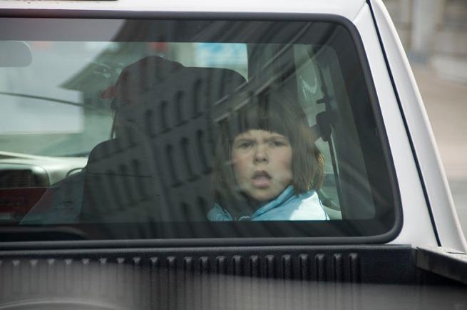 little-girl-in-back-window-od-truck
