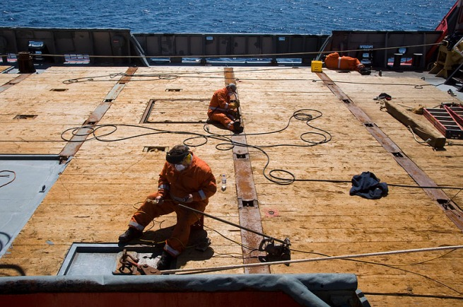 coast-guard-doing-repairs-to-deck