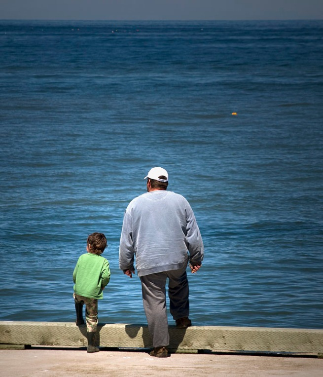 father and son at wharf