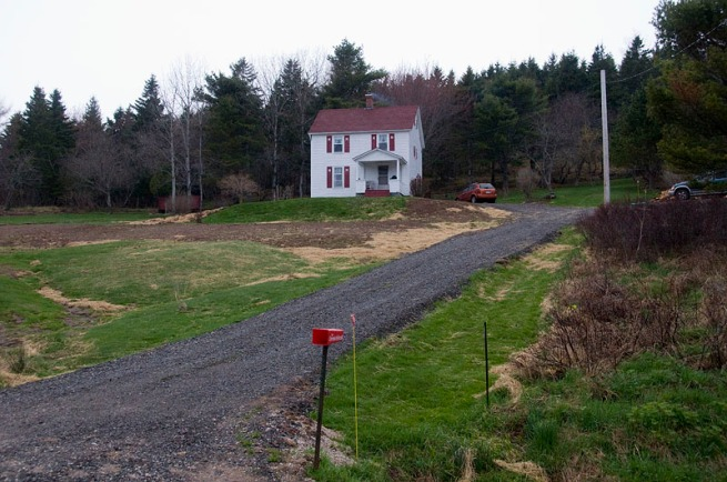 house on hill side near baddeck