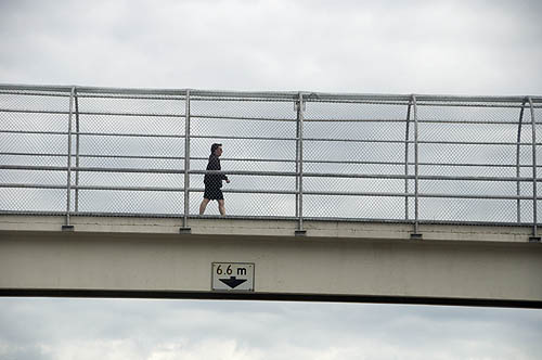 Tim Van Horn airdire overpass man walking