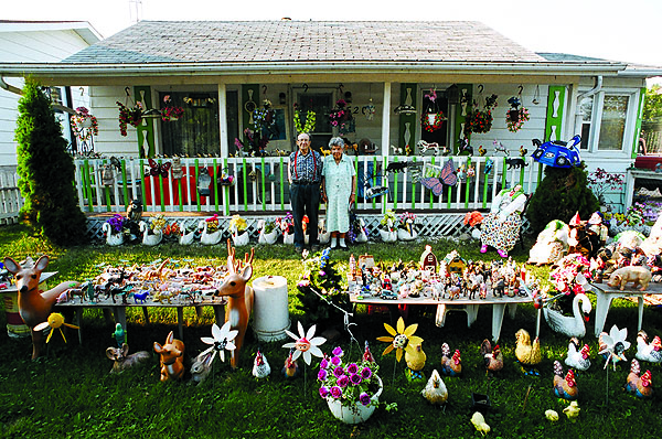 Newlyweds in front of their Bonnyville house, AB. August, 2004 - M